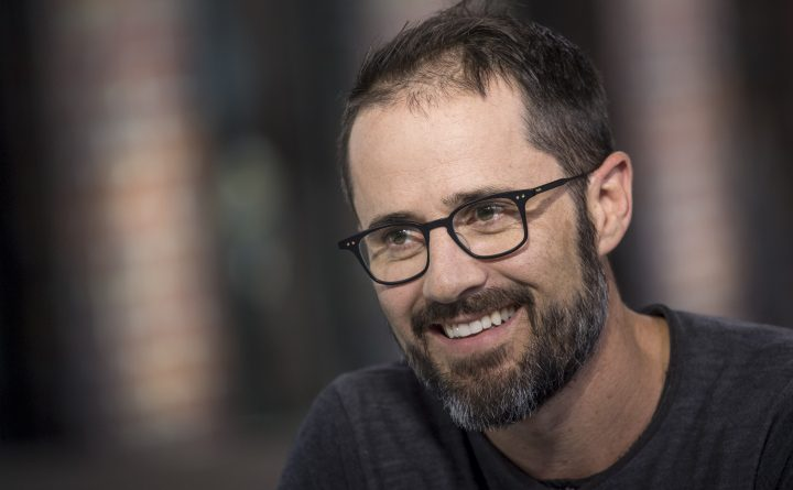 """Evan """"Ev"""" Williams, co-founder of Twitter Inc. and co-founder and chief executive officer of Medium.com, smiles during a Bloomberg West Television interview in San Francisco, California, U.S., on Tuesday, Aug. 30, 2016. Williams discussed the use of social media by presidential candidates, the growing concerns surrounding online harassment and the future of Twitter. Photographer: David Paul Morris/Bloomberg via Getty Images"""